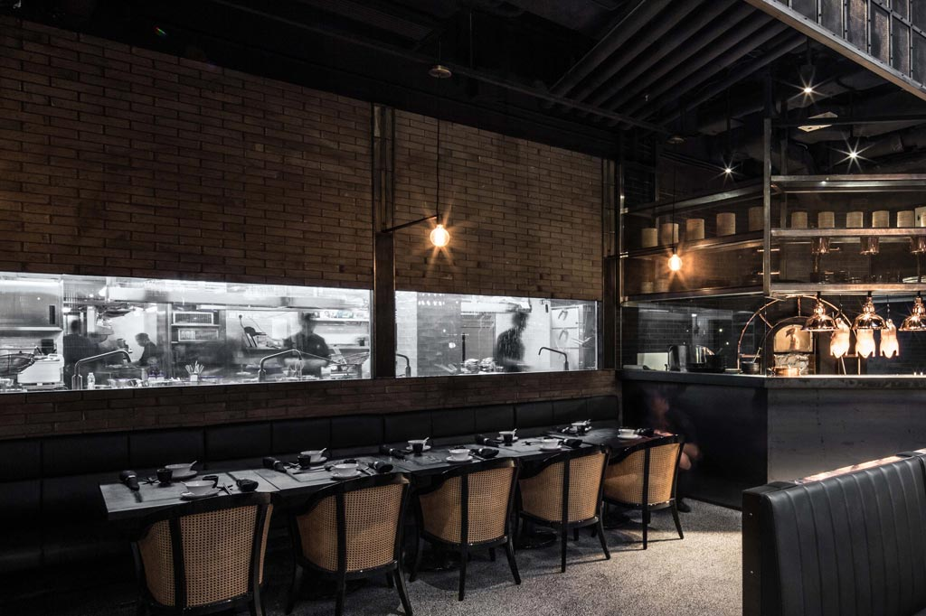 Kitchen with a view at Mott 32